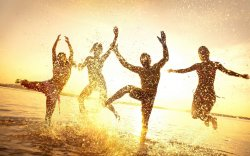 people-the-group-summer-water-drops-spray-happiness-girls-jump-horizon-sky-dawn-sunset-light-rays-silhouettes-outline-figures